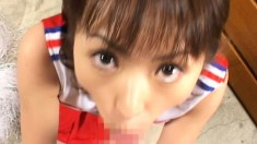 Barely legal Japanese cutie gets teased and covered in loads of cum