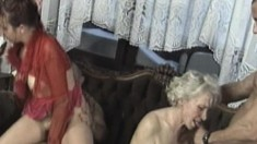 Kinky mature ladies getting fucked together by a group of hung studs