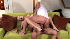 Buxom blonde slut Claudia Adams pleases two big dicks at the same time