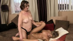 Chunky older brunette spreads her legs to get banged by a hot blonde