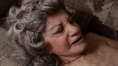 Horny grandma gets on all fours to take a huge black dong in her mouth