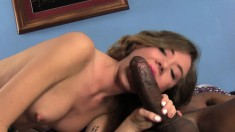 Stunning blonde Alison Faye works her hands and lips on a black shaft
