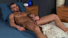 Tattooed stud Randy Rock slips out of his white briefs to play with his pencil boner