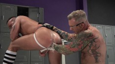 Hot hunk gets his lubed ass fisted by his tattooed pal in the locker room
