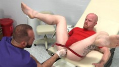 Bald dude in a jockstrap goes to the doctor for an anal examination