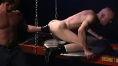 Bald headed hunk has a gorgeous stud's fist making his needy ass happy