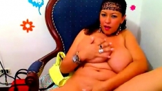 Large breasted MILF licks her tits