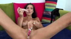 Busty brunette plays with her boobs while banged