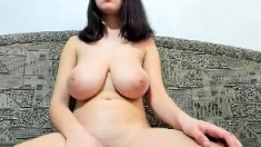 Busty plays with her amazing natural big boobs