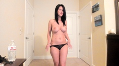Busty MILF dildoing her pussy on webcam